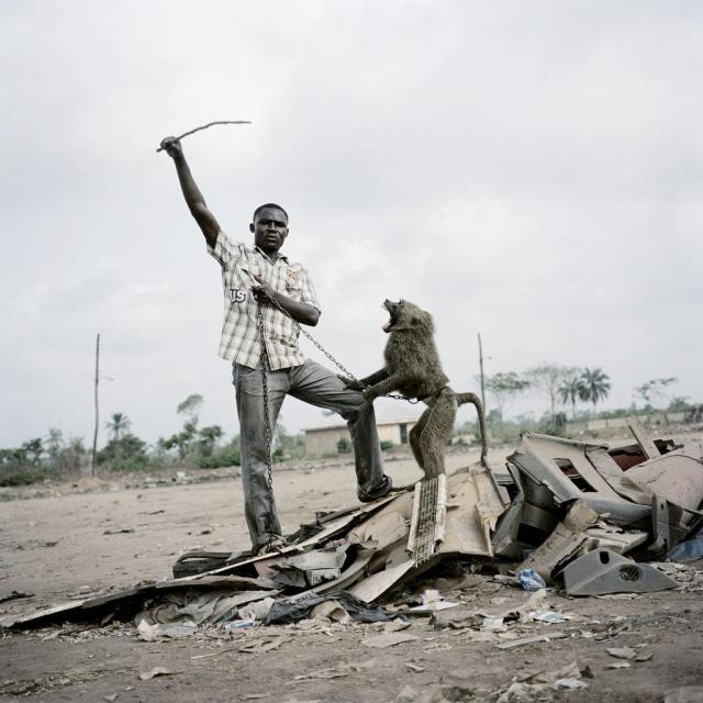 pieter-hugo-the-hyena-and-other-men-man-with-baboon-standing-portrait-alhaji-hassan-with-ajasco-ogere-remo-nigeria-2007